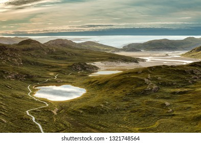 View from a top of Sugarloaf Mountain to Sandflugtdalen valley and the Greenlandic ice cap, Kangerlussuaq, west Greenland