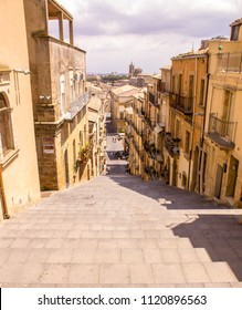 A view from the top of a very large 142 step staircase in Sicily, Italy.