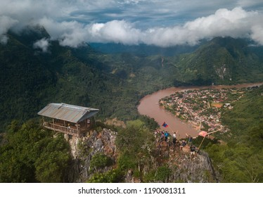 View from the top Viewpoint of Nong Khiaw, Laos. Stunning scenery with lush green mountains and mysterious clouds.