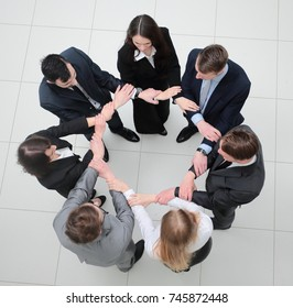 view from the top.business team standing in a circle