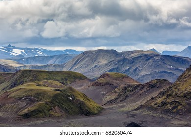 View of the tops of the mountains under a cloudy sky in Iceland
