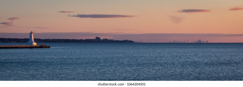 View of Toronto, Ontario, Canada from the Hamilton Harbor at Sunrise.  April 7th 2018.