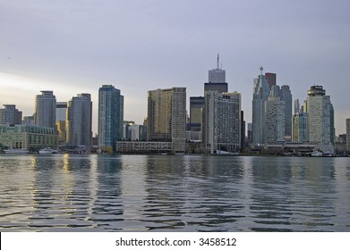 A view of the Toronto skyline (waterfront condos and financial district) from Lake Ontario near sunset.