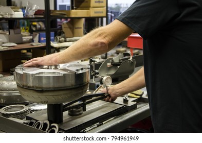 A view of a torque conveter being processed by a technician.
