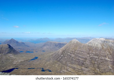 View from Torridon and Liathach in the Scottish Highlands with Blue Sky and Clouds, near Gairloch, Western Highlands, Scotland