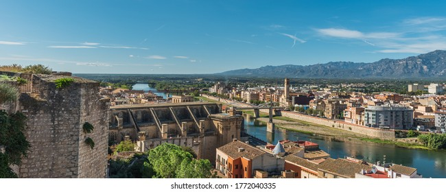 View of Tortosa Cathedral and city buildings, Catalonia, Tarragona, Spain. Copy space for text
