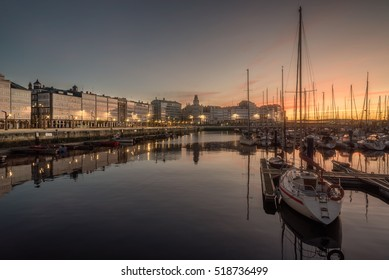 view of touristic sea sport harbor with modernist architecture buildings at down in A Coruña capital, Galicia, Spain. Relaxing leisure touristic popular must see destination place in Corunna.