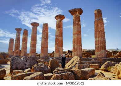 view of tourists taking pictures of the Heracles Temple in Agrigent, Sicily/Italy - 06.12.2018