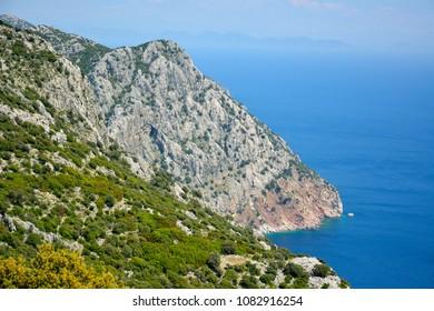 View toward cliffs hiding Ameliya beach on Bozburun peninsula near Marmaris resort town in Turkey. Ameliya beach is allegedly notorious for illegal human trafficking to Rhodes.