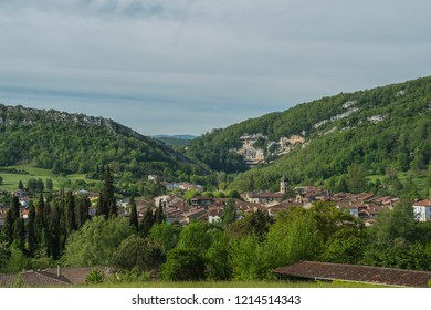 View towards ancient town in Ariege, France, with blue sky and mountains in background