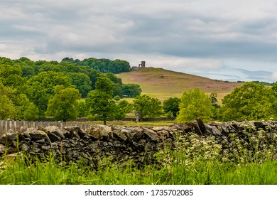 A view towards Bradgate Park from the shore of Cropston reservoir in Leicestershire in summertime