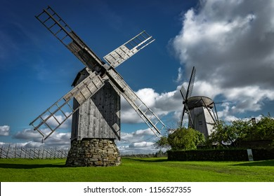 View towards Collection of old windmills at Angla Windmill Hill on a sunny day with blue sky and clouds in Saaremaa, Estonia