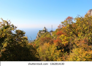 View towards Foros Church, also known as The Church of Christ's Resurrection, from road through the autumn forest. It's a popular tourist attraction on the outskirts of Yalta in the Crimea.