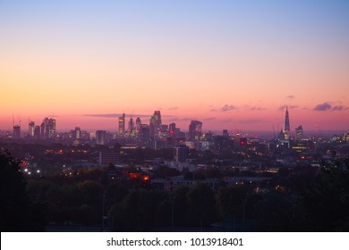 View towards London city skyline at sunrise from Parliament Hill in Hampstead Heath
