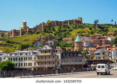 View towards Metekhi Bridge and the Old Town district of Tbilisi, the capital city of Georgia in Eastern Europe. Georgia, Tbilisi - June 2019