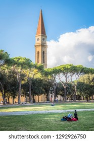 View of the tower of Arezzo Cathedral (Cattedrale di Ss. Donato e Pietro) from the park in the city of Arezzo in Tuscany, Italy