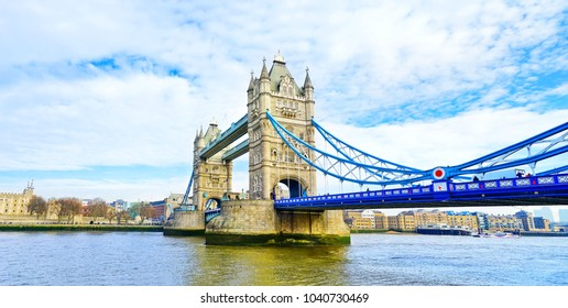 View of Tower Bridge in London on a sunny day.