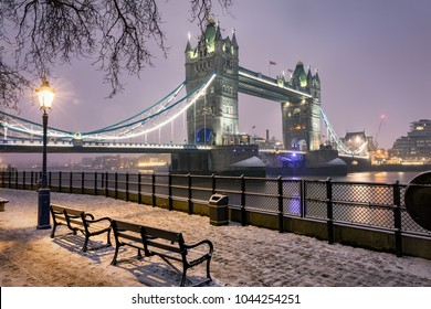 View to the Tower Bridge of London on a cold winter night with snow