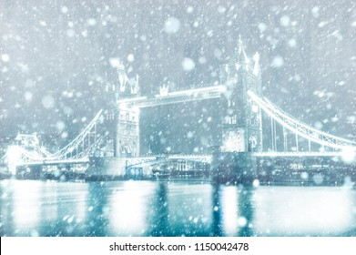 View of Tower Bridge in London with snow by night