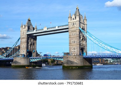 View to the Tower Bridge over the water with boats on a sunny day with a wonderful blue sky - London, Great Britain - 08/01/2015