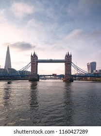 View of Tower Bridge and The Shard from a boat on the River Thames in London