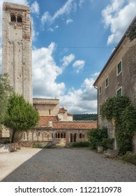 View of the tower and the colonnade of the cloister, dating back to the Christian period of the Pieve di San Giorgio di Valpolicella, municipality of Sant'Ambrogio di Valpolicella, in the province of