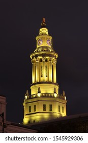 View of tower of Denver City Council at night. Lighted tower with clock on dark background. Denver, Colorado.