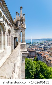 View from the tower of historic St. Peter's cathedral to the old town of Geneva, Switzerland, fountain Jet d'eau in the background