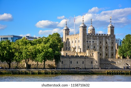 View of the Tower of London, a castle and a former prison in London, England, from the River Thames. The Tower of London, today a museum, is a fortified complex that includes multiple buildings