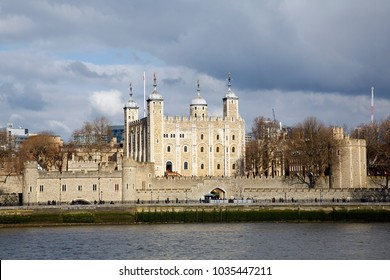 View of the Tower of London and Traitors Gate on the banks of the Thames River.  The gate was built by Edward I to provide a water gate entrance to the Tower.