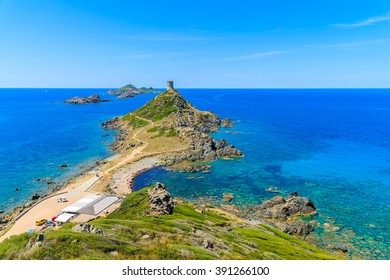View of tower on Cape de la Parata and beautiful coast of Corsica island, France