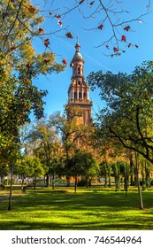 View of the Tower on Plaza Espana from the Park of Maria Luisa (Parque de Maria Luisa). Seville (Sevilla), Andalusia, Spain.