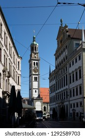 View to tower of St. Peter and townhall with blue sky in city Augsburg, Bavaria, Germany