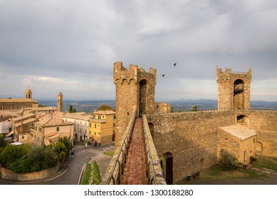 View of tower and wall of the fortress Montalcino Fortezza, city streets and surroundings of Montalcino, Tuscany, Italy