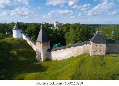 View of the towers of the Holy Dormition Pskov-Caves Monastery on a sunny June day (aerial survey). Pechory, Russia