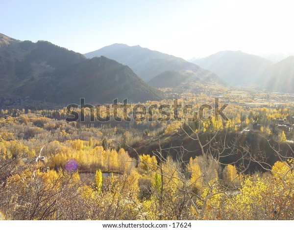 View of the town of Aspen Colorado from the Northeast on Red Mountain at sunset