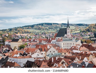 View of the town of Cesky Krumlov and the surrounding fields in autumn