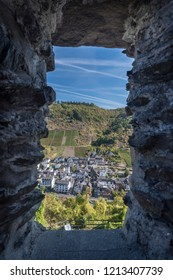 View of the town of Cochem framed by a stone window in Cochem Castle, Germany