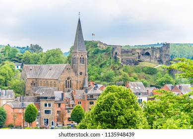 View at the town La Roche en Ardenne with fertress ruins and church, Belgium