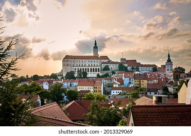 A view of the town of Mikulov in southern Moravia in the Czech Republic. A tourist destination under a dramatic sky with the sunset. - Shutterstock ID 2013329069
