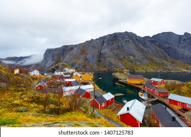 View to town Nusfjord with Mountains on side