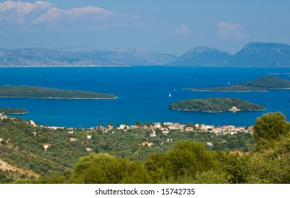 View to the town Nydri. Island of  Scorpio on the  right in the middle of the sea.