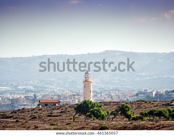 View of the town and the old lighthouse of Paphos, Cyprus. Attention: a long distance shoot on a heat day has a little effect on the sharpness (the distorting effect is caused by the heat waves).