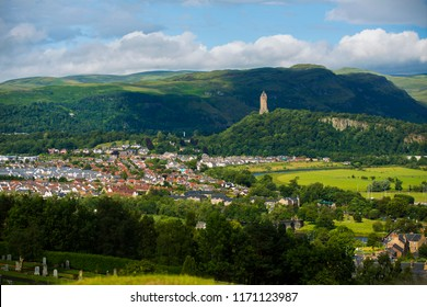 A view of the town of Stirling, Scotland with the William Wallace Monument in the distance.