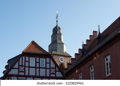View of townhall and catholic church in Obernburg am Main during a bright day