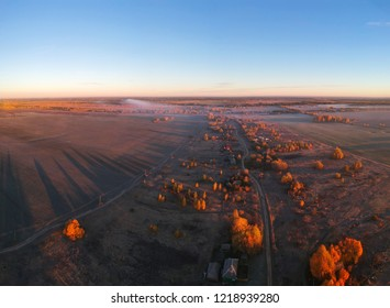 View of the track and fields at dawn with quadrocopter