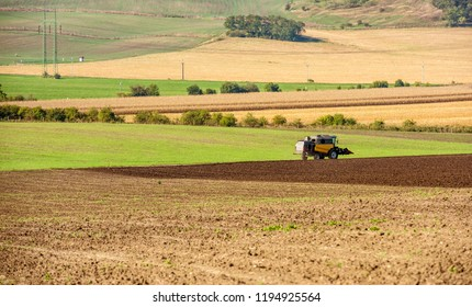 View of tractor plowing the field of Moavia