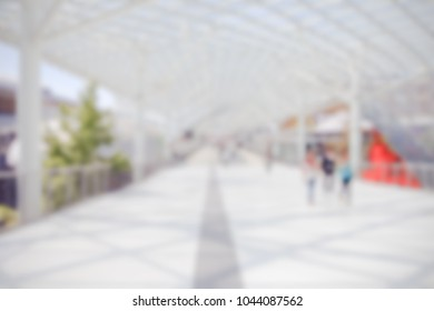 View of a trade show location. Background with an intentional blur effect applied. People not recognizable.