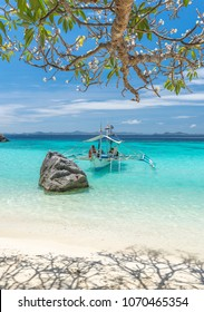 View of traditional boat at Coron Island beach, Philippines. Coron Island is a wedge-shaped limestone island in the province of Palawan.