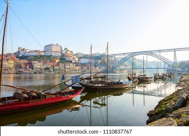 View of  traditional  boats in the morning on river Douro with Porto city in the background, Portugal.